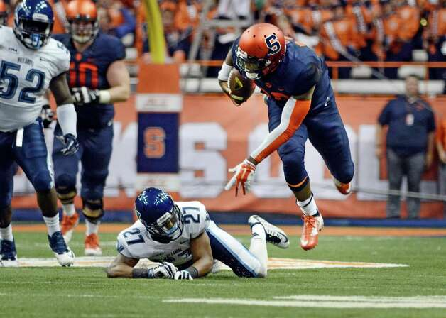 Syracuse Terrel Hunt, right, goes flying after being tripped by Villanova's Malik Reaves during an NCAA college football game at the Carrier Dome, Friday, Aug. 29, 2014 in Syracuse, N.Y. (AP Photo/Heather Ainsworth) ORG XMIT: NYHA203 Photo: Heather Ainsworth / FR120665 AP