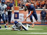Syracuse Terrel Hunt, right, goes flying after being tripped by Villanova's Malik Reaves during an NCAA college football game at the Carrier Dome, Friday, Aug. 29, 2014 in Syracuse, N.Y. (AP Photo/Heather Ainsworth) ORG XMIT: NYHA203