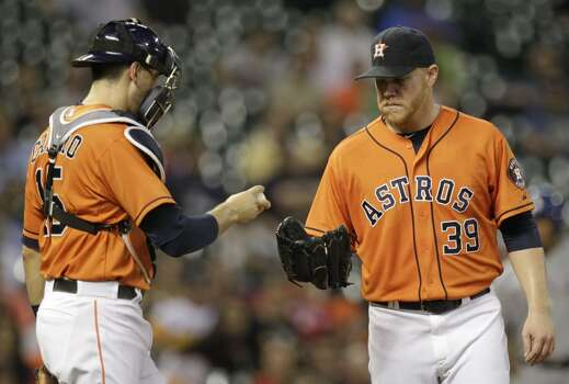 August 29: Rangers 13, Astros 6  Astros starter Brett Oberholtzer, right, had a rough go of it in the second game of a four-game series against the rival Rangers.  Record: 57-79. Photo: Melissa Phillip, Houston Chronicle