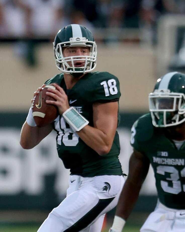 Michigan State's Connor Cook looks to pass against Jacksonville State during first-quarter action on Friday, Aug. 29, 2014, at Spartan Stadium in East Lansing, Mich. (Kirthmon F. Dozier/Detroit Free Press/MCT) Photo: Kirthmon F. Dozier, McClatchy-Tribune News Service