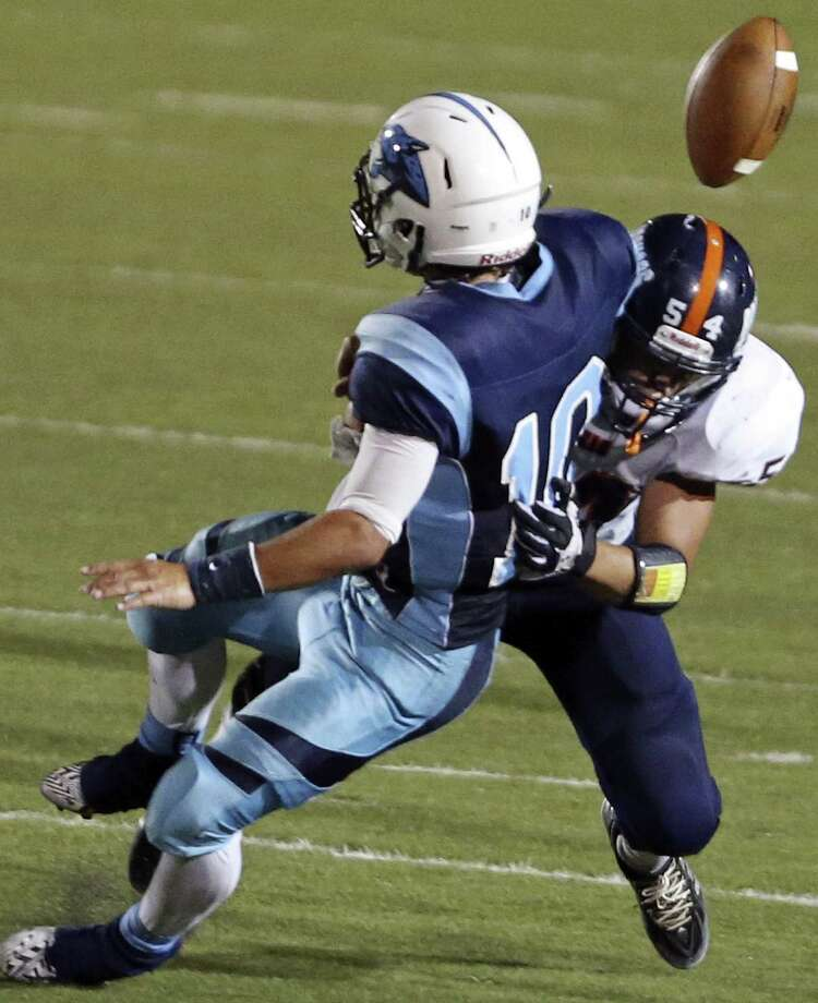 Johnson's Josh Theissen (left) fumbles the ball as he is hit by Brandeis' Caleb Worfe during the second half Friday. With the win, the Broncos improved to 6-2 all-time head-to-head. Photo: Edward A. Ornelas / San Antonio Express-News / © 2014 San Antonio Express-News