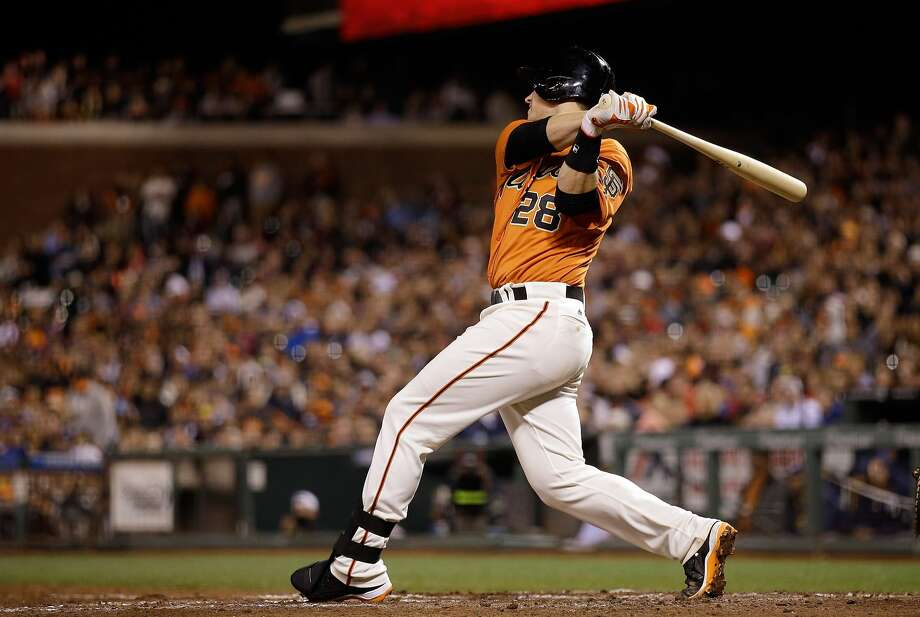 Buster Posey's two-run triple was one of his five hits. He's 20 for his last 40, with five home runs and 13 RBIs in that span. Photo: Ezra Shaw, Getty Images