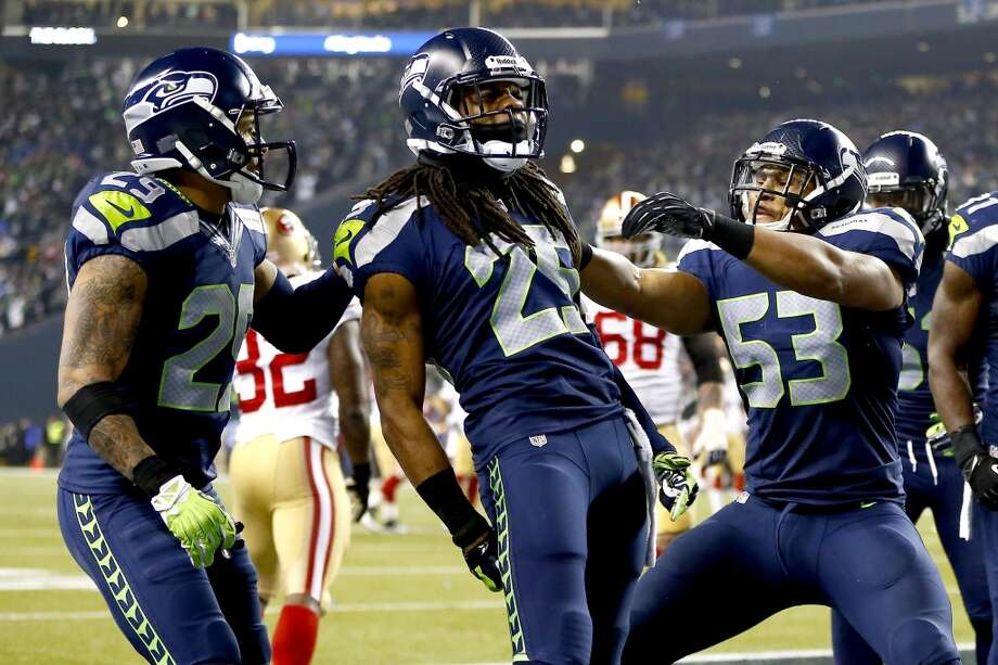 Cornerback Richard Sherman of the Seattle Seahawks celebrates after he tips the ball leading to an interception by outside linebacker Malcolm Smith to clinch the victory for the Seahawks against the San Francisco 49ers during the 2014 NFC Championship at CenturyLink Field on January 19, 2014 in Seattle, Washington. Photo: Jonathan Ferrey, Getty Images