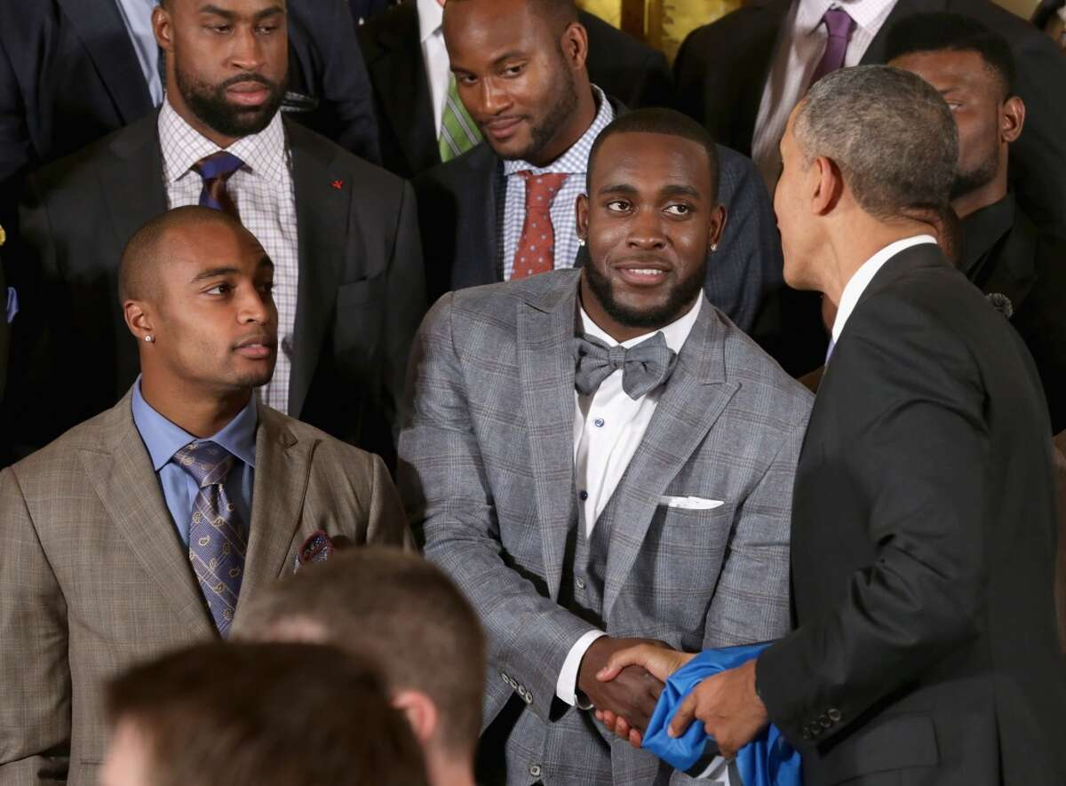 WASHINGTON, DC - MAY 21: U.S. President Barack Obama (R) congratulates Seattle Seahawks players Doug Baldwin (L) and Kam Chancellor during a ceremony honoring the players, coaches and executives of the Super Bowl XLVIII champions in the East Room of the White House May 21, 2014 in Washington, DC. Obama honored the Seahawks and their 43-8 win over the Denver Broncos last February. (Photo by Chip Somodevilla/Getty Images)