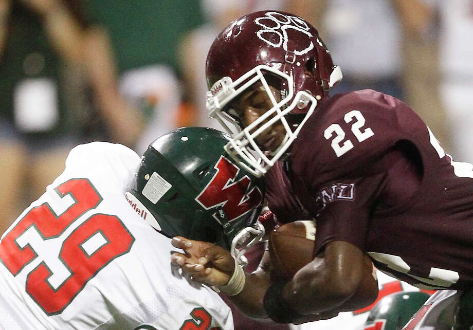 Cy-Fair running back Jacorey Aleem (22) is hit by Woodlands defensive back Talon Baskin (29) during the second half of a high school football game at the Berry Center on Friday, Aug. 29, 2014, in Cypress. Photo: J. Patric Schneider, For The Chronicle / © 2014 Houston Chronicle