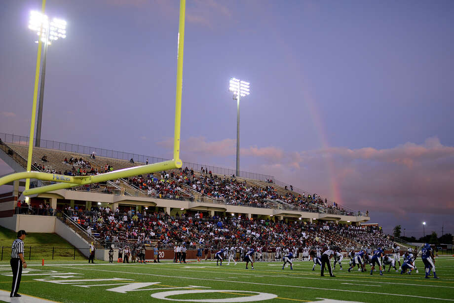 The Central Jaguars and the West Brook Bruins are treated to a rainbow over the stadium as they braved the rain at the Carroll Thomas Stadium Friday night. Photo by Drew Loker. Photo: Drew Loker / www.DrewLoker.com