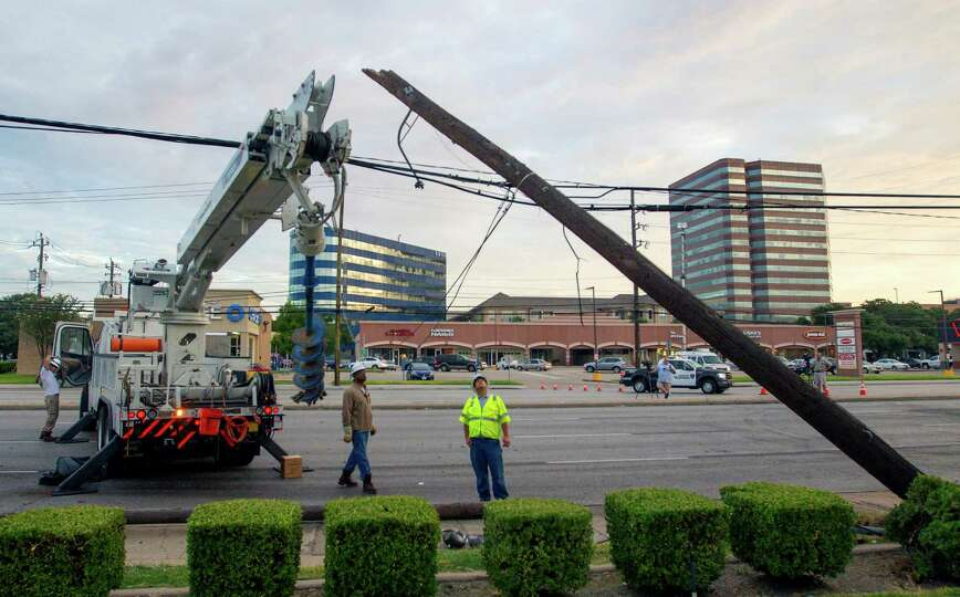 Crews work a scene after a crash early Friday, Aug. 29, 2014, in Houston. The wreck reportedly occur