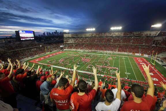 "University of Houston fans raise ""Cougar Paws"" as the UH band plays the alma mater before the first quarter of an NCAA football game against Texas-San Antonio at the new TDECU Stadium, Friday, Aug. 29, 2014, in Houston."