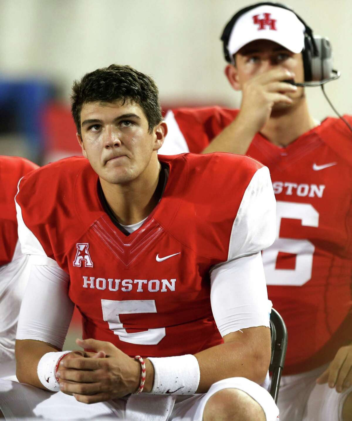 Houston quarterback John O'Korn (5) sits on the sidelines after throwing an interception against UTSA during the second half of an NCAA football game at TDECU Stadium, Friday, Aug. 29, 2014, in Houston.
