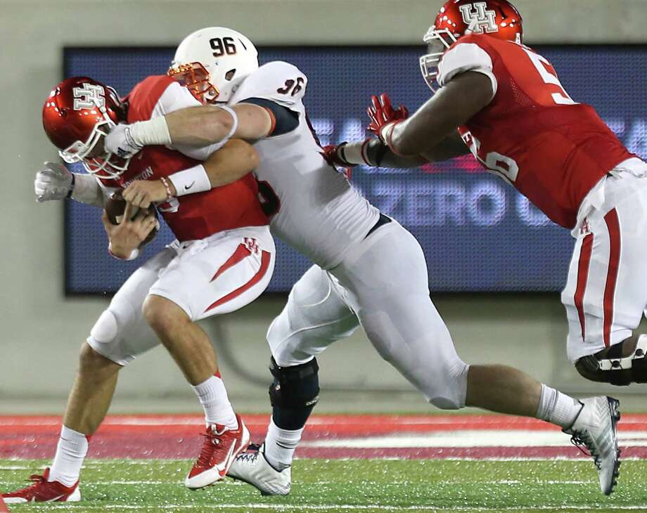 Houston quarterback John O'Korn (5) is sacked by UTSA defensive tackle Jason Neill (96) during the second quarter in an NCAA football game at TDECU Stadium, Friday, Aug. 29, 2014, in Houston. Photo: Brett Coomer, Houston Chronicle / © 2014  Houston Chronicle