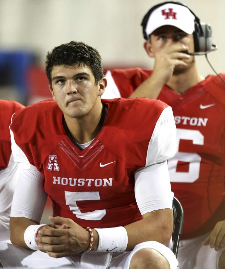 Houston quarterback John O'Korn (5) sits on the sidelines after throwing an interception against UTSA during the second half of an NCAA football game at TDECU Stadium, Friday, Aug. 29, 2014, in Houston. ( Brett Coomer / Houston Chronicle ) Photo: Brett Coomer, Houston Chronicle