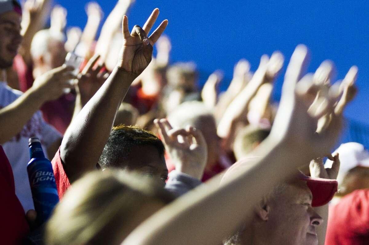 University of Houston fans raise their