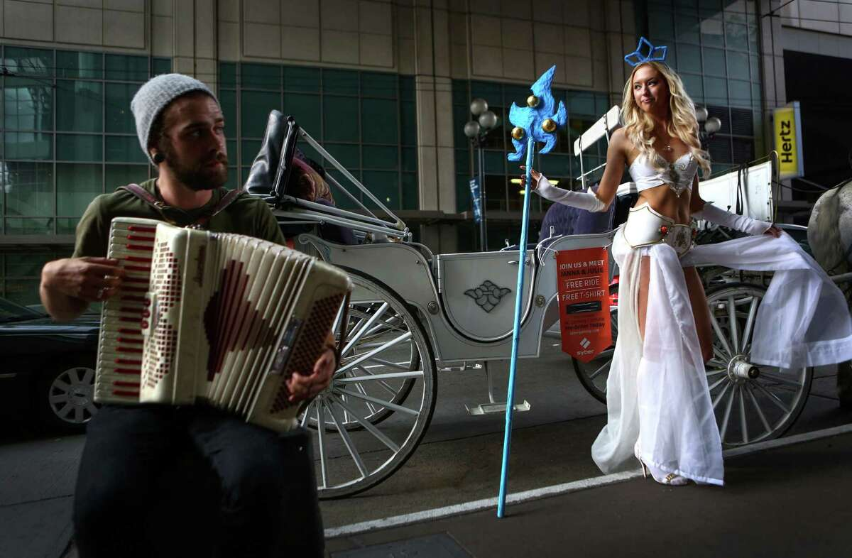 Janna Niki is dressed as Janna from League of Legends as Andrew Jamieson plays an accordion during the Penny Arcade Expo at the Washington State Convention Center. The event is expected to be attended by 85,000 gamers and will include concerts, game tournaments and previews of upcoming titles. Photographed on Friday, August 29, 2014.