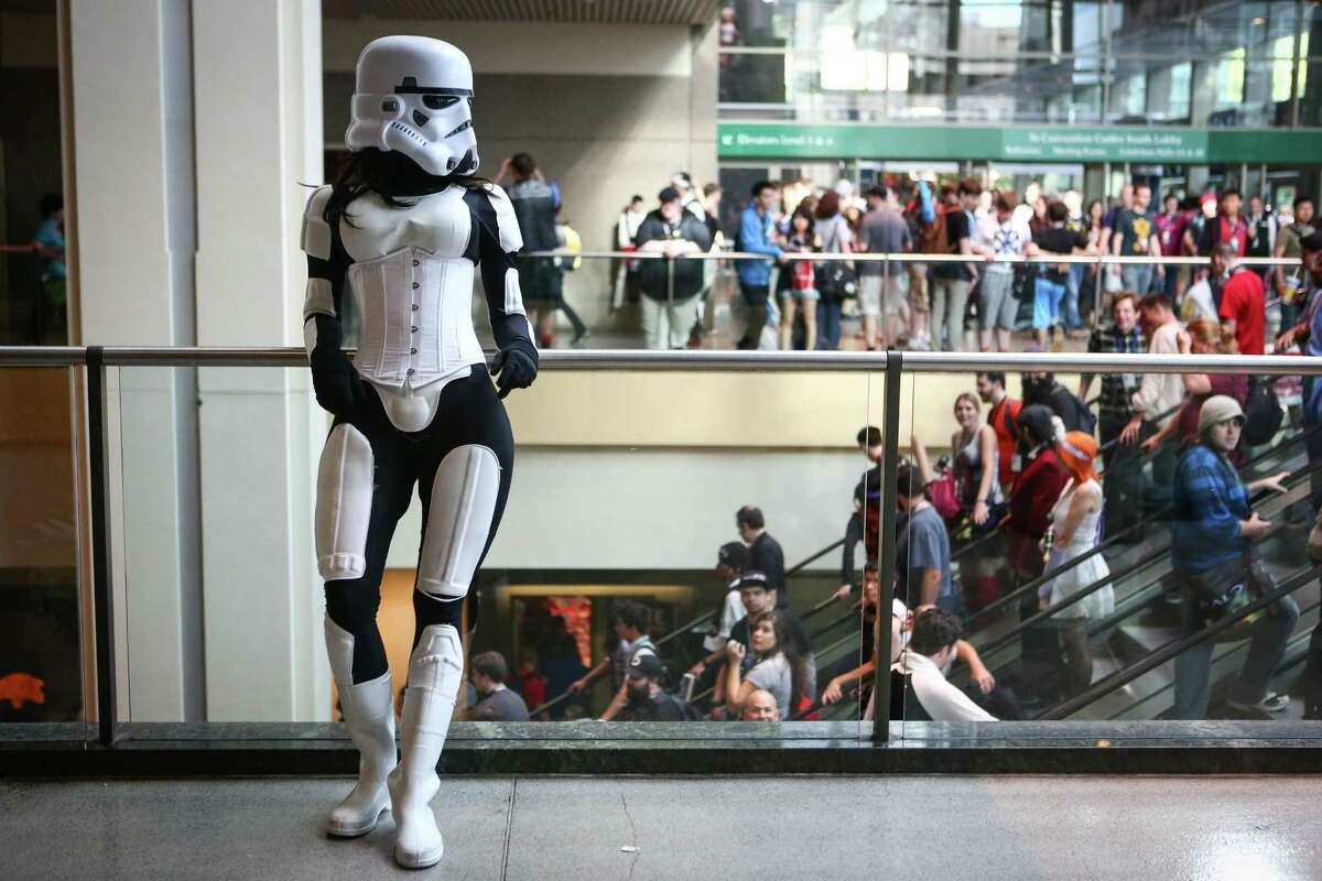 A female Storm Trooper looks over the crowd during the Penny Arcade Expo at the Washington State Convention Center. The event is expected to be attended by 85,000 gamers and will include concerts, game tournaments and previews of upcoming titles. Photographed on Friday, August 29, 2014.