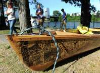 A paper boat, formed from an REI canoe, features the drawings of local artist Patrick Porter on Saturday, Aug. 30, 2014, at the Troy Town Dock and Marina in Troy, N.Y. The boat is in the SeaChange 2014 flotilla to raise awareness about climate change. (Cindy Schultz / Times Union)