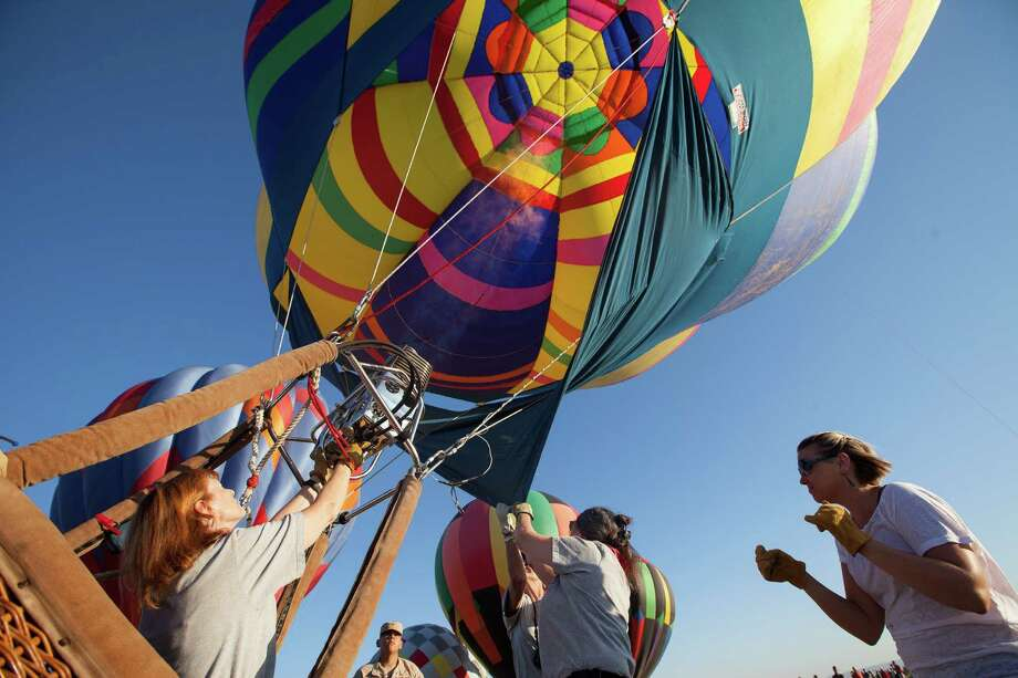 A hot air balloon is filled with hot air as it is prepared to be launched during the annual Big Bend Balloon Bash in Alpine, Texas on Saturday, Aug. 30, 2014. Photo: Courtney Sacco, Associated Press / Odessa American