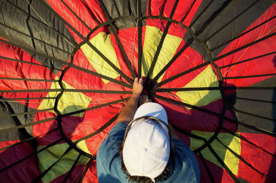 Hot air ballon pilot Walter Hawkins check over his balloon as he prepares launch during the annual Big Bend Balloon Bash in Alpine, Texas on Saturday, Aug. 30, 2014. Photo: Courtney Sacco, Associated Press / Odessa American