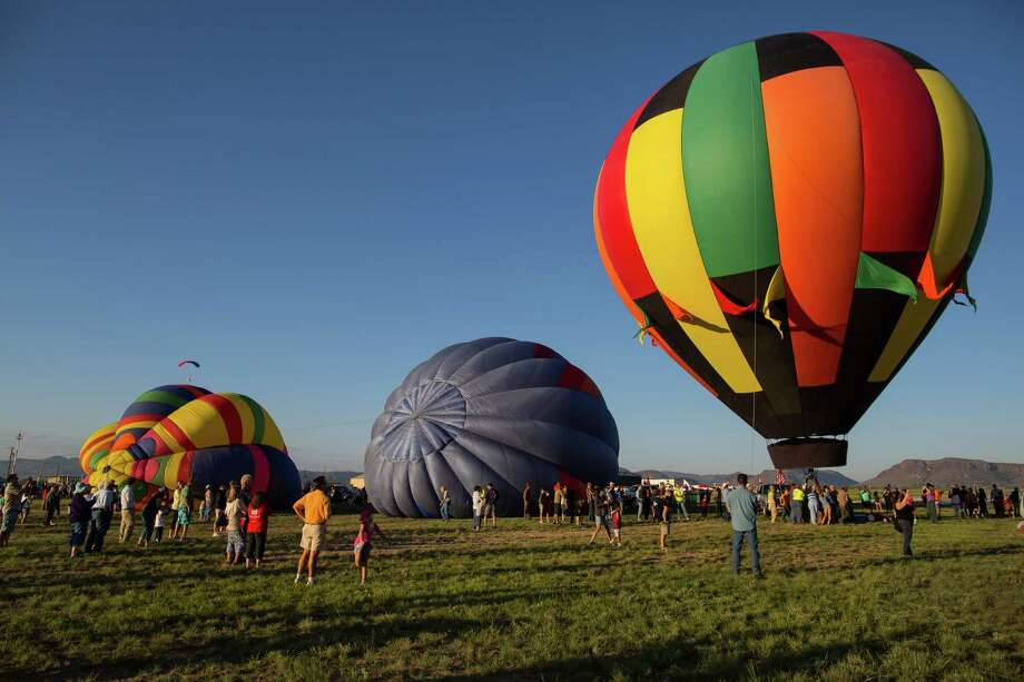 People gather at Casparis Airport to watch the annual  Big Bend Balloon Bash in Alpine, Texas on Saturday, Aug. 30, 2014. Photo: Courtney Sacco, Associated Press / Odessa American