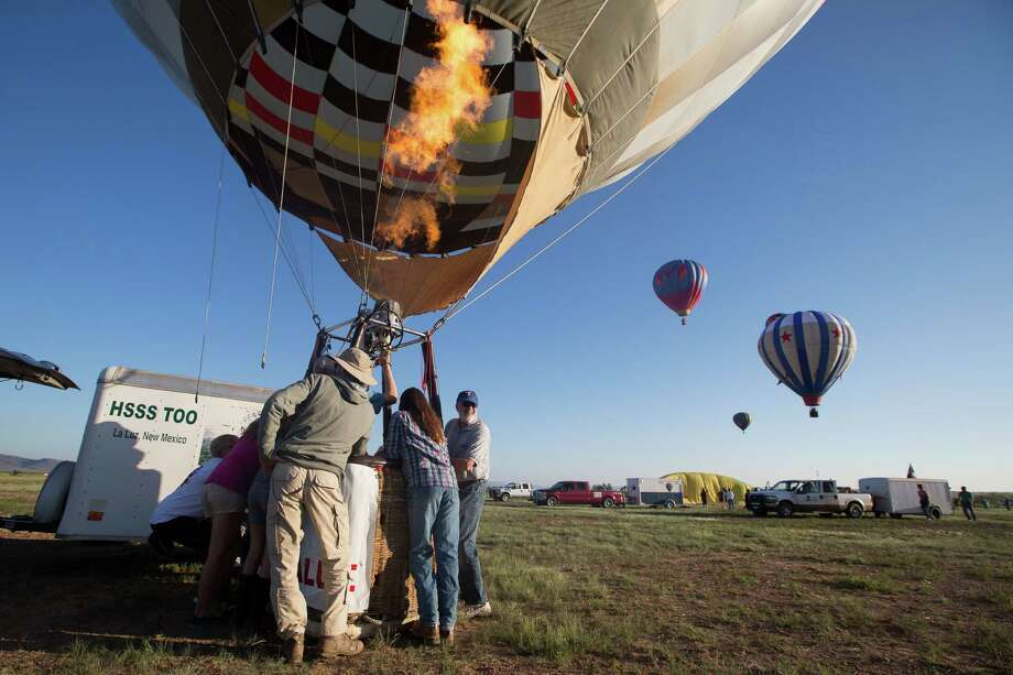 A hot air balloon is launched during the annual Big Bend Balloon Bash in Alpine, Texas on Saturday, Aug. 30, 2014. Photo: Courtney Sacco, Associated Press / Odessa American