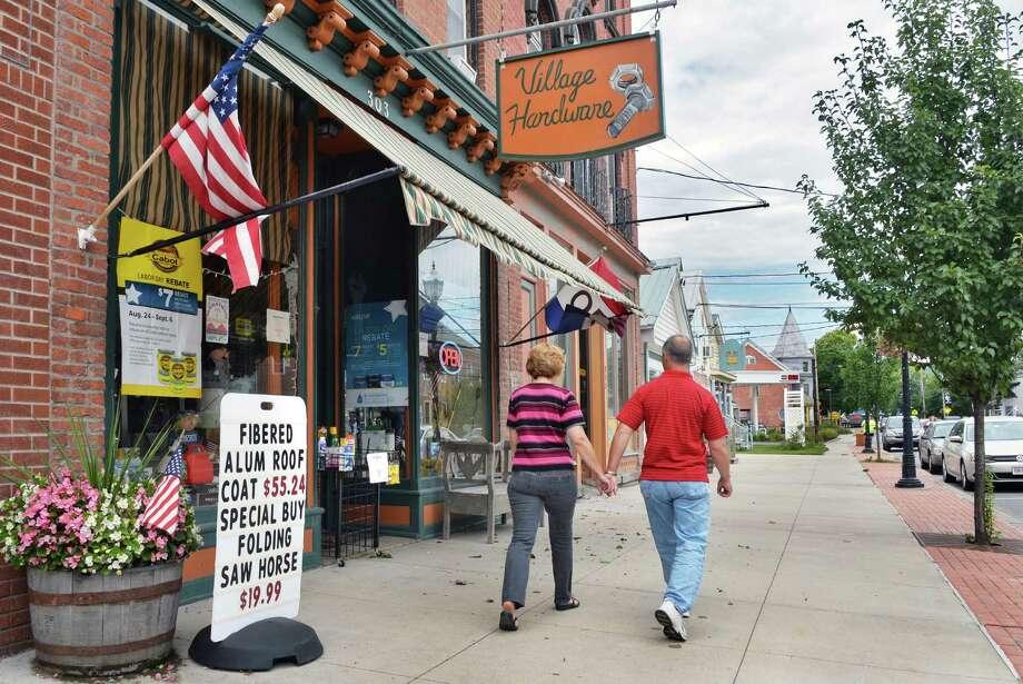 A couple strolls the sidewalk on Main Street Thursday Aug. 28, 2014, in Schoharie, N.Y.  (John Carl D'Annibale / Times Union) Photo: John Carl D'Annibale / 00028363A