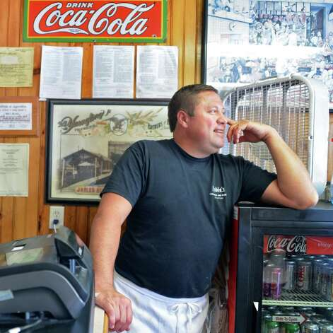 Hubie's Restaurant owner Chris Hubbard describes the community's recovery from Irene's flooding three years ago Thursday Aug. 28, 2014, at Hubie's on Main St. in Middleburgh, N.Y.  (John Carl D'Annibale / Times Union) Photo: John Carl D'Annibale / 00028363A