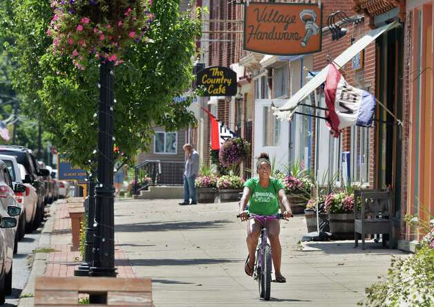 Jaylah Bell, 13, of Schoharie rides her bike on Main Street Thursday, Aug. 28, 2014, in Schoharie, N.Y.  (John Carl D'Annibale / Times Union) Photo: John Carl D'Annibale / 00028363A