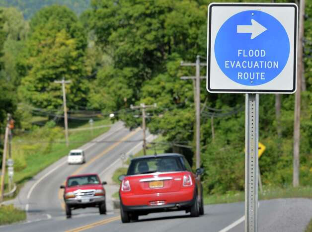 Traffic passes by a flood evacuation sign on Route 30 Thursday, Aug. 28, 2014, in Schoharie, N.Y.  (John Carl D'Annibale / Times Union) Photo: John Carl D'Annibale / 00028363A