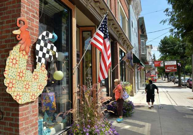 Window shopping along Main St. Thursday Aug. 28, 2014, in Middleburgh, N.Y.  (John Carl D'Annibale / Times Union) Photo: John Carl D'Annibale / 00028363A