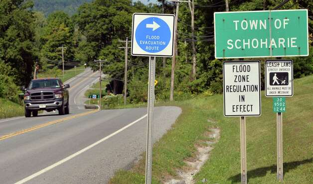 Traffic passes by flood evacuation signs on Route 30, Thursday, Aug. 28, 2014, in Schoharie, N.Y.  (John Carl D'Annibale / Times Union) Photo: John Carl D'Annibale / 00028363A