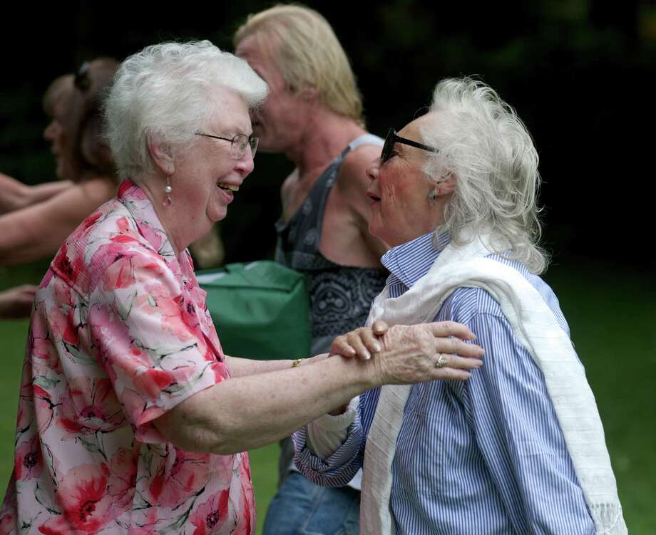 Peggy (Rockwell) King, 85, of New Mexico, left, greets a friend and high school class mate, Dolores Michael, at the 85th annual Rockwell family reunion, on Saturday, August 30, 2014. King and Michael both graduated from Bethel High School in 1947. The reunion was held at the Rockwell family farm, on Rockwell Road, in Bethel, Conn. Photo: H John Voorhees III / The News-Times Freelance