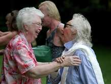 Peggy (Rockwell) King, 85, of New Mexico, left, greets a friend and high school class mate, Dolores Michael, at the 85th annual Rockwell family reunion, on Saturday, August 30, 2014. King and Michael both graduated from Bethel High School in 1947. The reunion was held at the Rockwell family farm, on Rockwell Road, in Bethel, Conn.