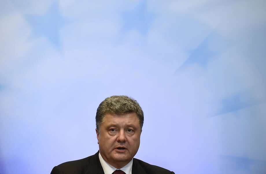 "Ukrainian President Petro Poroshenko told a summit of the European Union's leaders that a strong response was needed to Russia's ""military aggression."" Photo: John Thys, AFP/Getty Images"