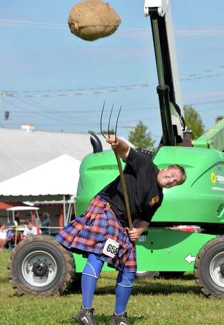 Bill Waddell of Springfield, NH, competes in the sheaf toss during the annual Scottish Games at the Altamont Fair Grounds Saturday August 30, 2014, in Altamont, NY. Waddell tossed the 20lb. bag over 32 feet.   (John Carl D'Annibale / Times Union) Photo: John Carl D'Annibale / 00028407A