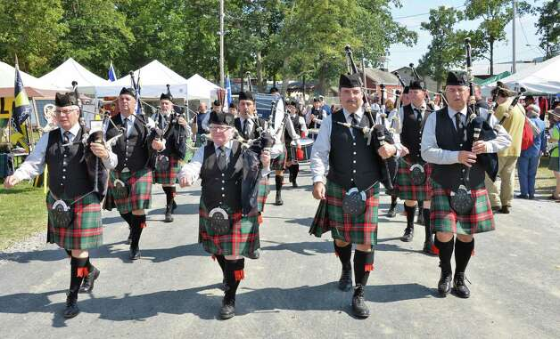 The Saffron United Pipe Band of Babylon, NY, marches to the pipe band competition at the Scottish Games at the Altamont Fair Grounds Saturday August 30, 2014, in Altamont, NY.  (John Carl D'Annibale / Times Union) Photo: John Carl D'Annibale / 00028407A