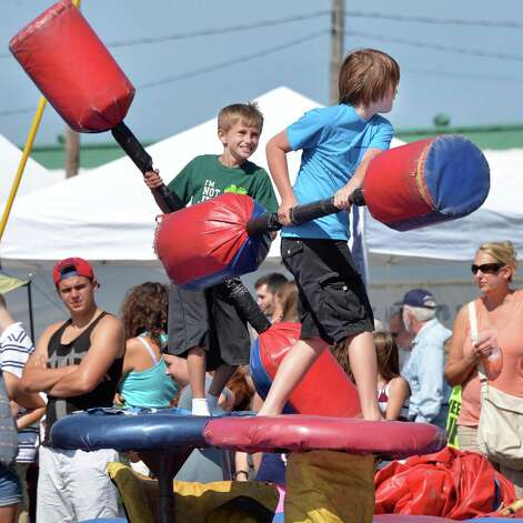 Dakota Bowie, 10, left, and Noah Waldie, 10, both of Mechanicville try their hand at jousting at the Scottish Games at the Altamont Fair Grounds Saturday August 30, 2014, in Altamont, NY.  (John Carl D'Annibale / Times Union) Photo: John Carl D'Annibale / 00028407A