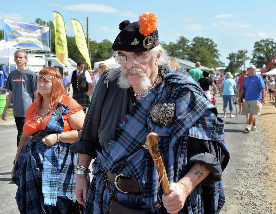 Jane Pope of Ilion and Bob Arnold of Albany, both of the Clan Mackay make their way along the attractions at the Scottish Games at the Altamont Fair Grounds Saturday August 30, 2014, in Altamont, NY.  (John Carl D'Annibale / Times Union) Photo: John Carl D'Annibale / 00028407A