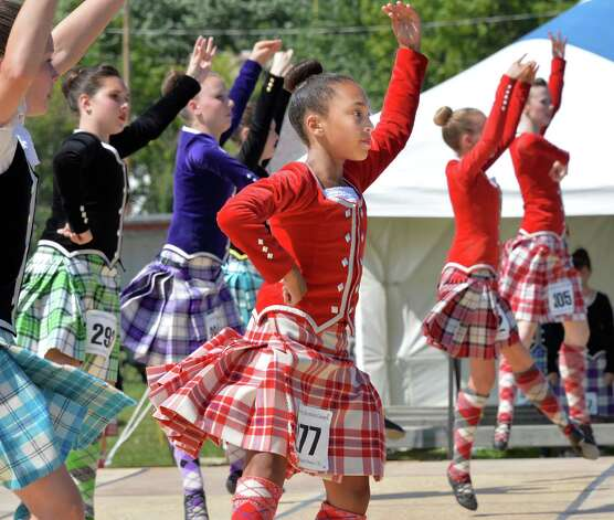Halley Romain, center, competes in the under 14 premier class Highland dance at the Scottish Games at the Altamont Fair Grounds Saturday August 30, 2014, in Altamont, NY.  (John Carl D'Annibale / Times Union) Photo: John Carl D'Annibale / 00028407A