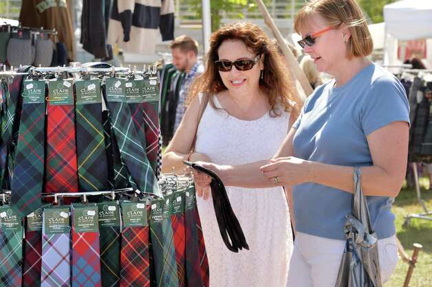 April Barron, left, of Chicago and Joanne Murray of Lenox, Mass shop for Tartan ties at the Scottish Games at the Altamont Fair Grounds Saturday August 30, 2014, in Altamont, NY.  (John Carl D'Annibale / Times Union) Photo: John Carl D'Annibale / 00028407A