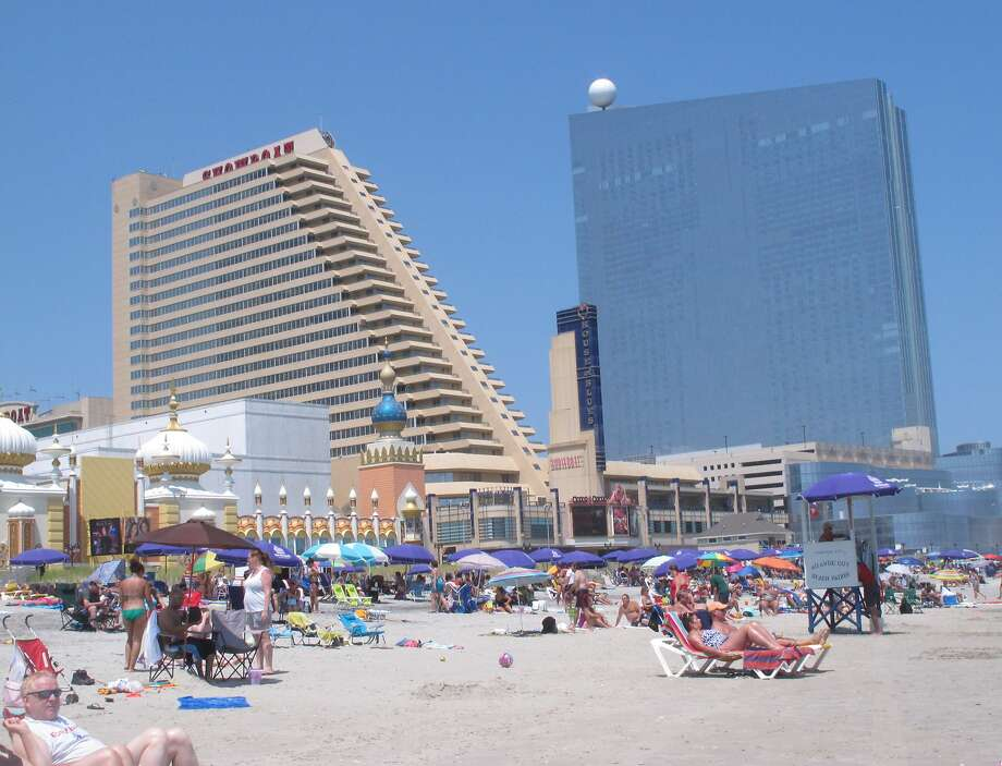 The Showboat (left) and Revel both are closing this week in Atlantic City. The city will end 2014 with eight casinos in operation after beginning the year with 12. Photo: Wayne Parry, Associated Press