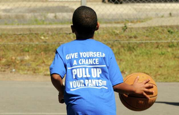 Haisi Mayben, 7, wears a T-shirt with the message, Give Yourself a Chance, Pull Up Your Pants!!!, during a game of basketball as part of as part of a Take Back Our Community/ Back to School Celebration/ Call to Prayer event  at Ingalls Avenue Playground on Saturday Aug. 30, 2014 in Troy, N.Y. (Michael P. Farrell/Times Union) Photo: Michael P. Farrell