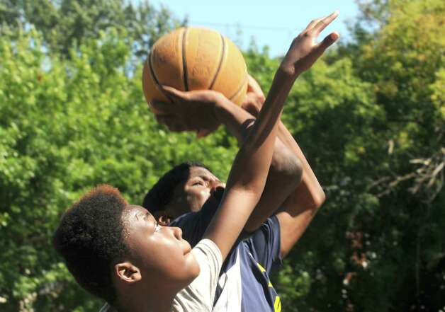 Boys play a game of basketball as part of a Take Back Our Community/ Back to School Celebration/ Call to Prayer event at Ingalls Avenue Playground on Saturday Aug. 30, 2014 in Troy, N.Y. (Michael P. Farrell/Times Union) Photo: Michael P. Farrell
