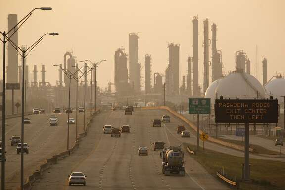 A petroleum refinery along State Highway 225 in Pasadena, near Houston, Sept. 16, 2011. An examination of the president's decision to reject tougher smog standards shows how the interests of his re-election campaign could be influencing White House policy. (Michael Stravato/The New York Times)