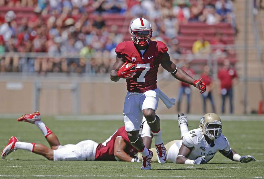 Stanford's Ty Montgomery is off and running for a first-quarter, 60-yard punt return touchdown, as the Cardinal romp in their season opener. Photo: Michael Macor, The Chronicle