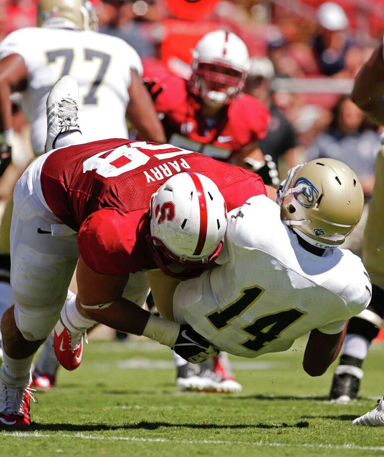 Stanford nose tackle David Parry takes down UC Davis' London Lace for one of his four sacks this season. Photo: Michael Macor / The Chronicle / ONLINE_YES