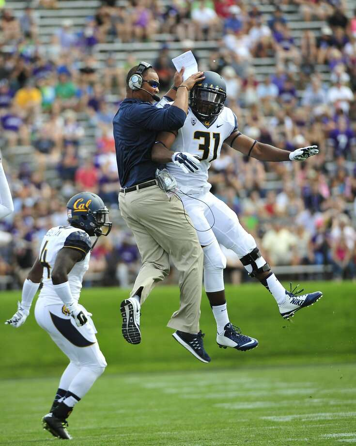 EVANSTON, IL- AUGUST 30: Raymond Davison #31 of the California Golden Bears  celebrates a play with running backs coordinator Pierre Ingram during the first half in a game against the Northwestern Wildcats on August 30, 2014 at Ryan Field in Evanston, Illinois.  (Photo by David Banks/Getty Images) Photo: David Banks, Getty Images