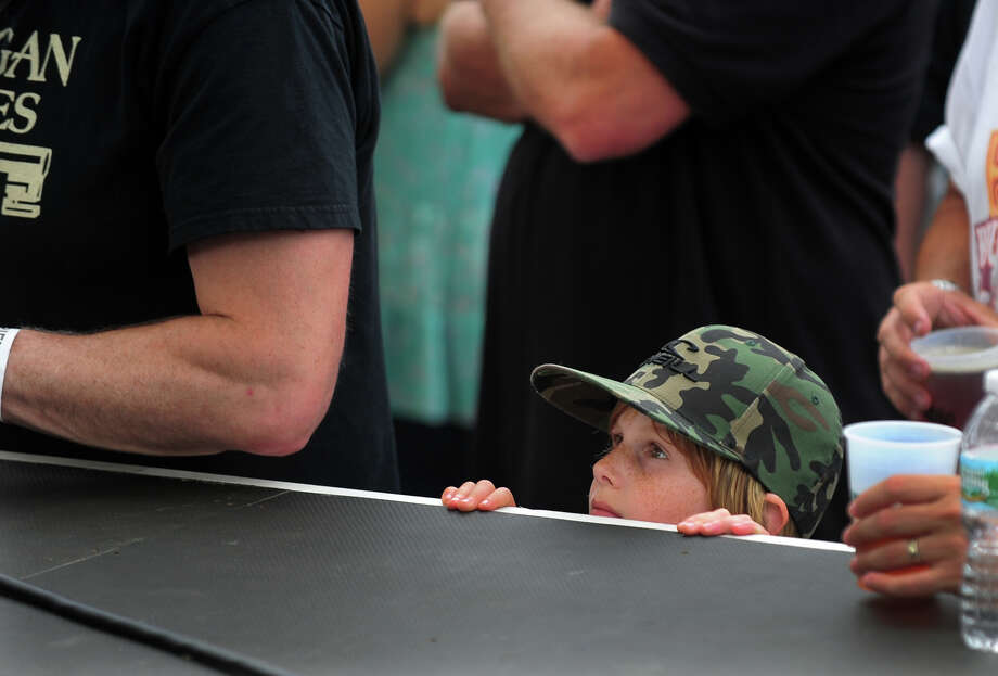 Dylan Cohen, of Boston, watches Raw Oyster Cult perform at the 7th Annual Blues Views and BBQ Festival at the Levitt Pavillion in Westport, Conn. on Saturday, Aug. 30, 2014. Photo: Christian Abraham / Connecticut Post