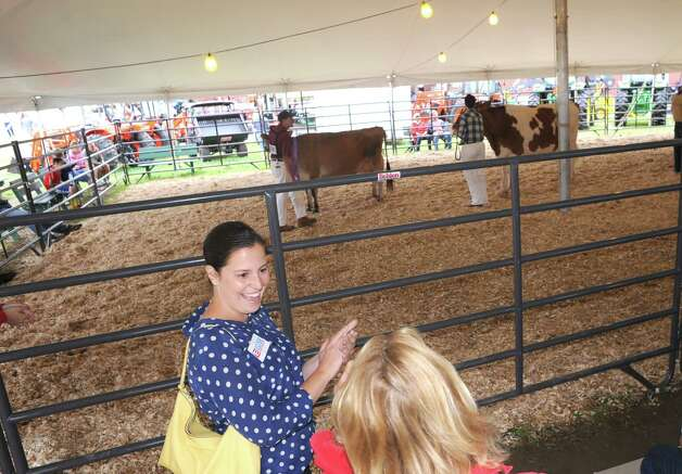Elise Stefanik, left, Republican candidate for congress in the 21st district, speaks to Dawn Sharts while she campaigning at the Washington County Fair Friday, Aug. 22, 2014, in Greenwich, N.Y. (Michael P. Farrell/Times Union) Photo: Michael P. Farrell / 00028249A