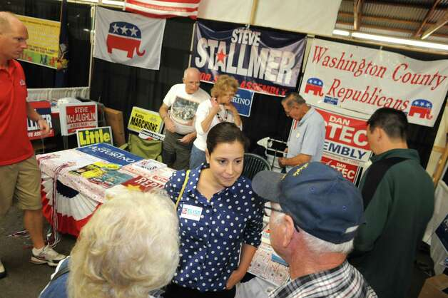 Elise Stefanik, center, Republican candidate for congress in the 21st district, speaks with Ruth and Vernon Scribner while she campaigned at the Washington County Fair on Friday, Aug. 22, 2014, in Greenwich, N.Y. (Michael P. Farrell/Times Union) Photo: Michael P. Farrell / 00028249A