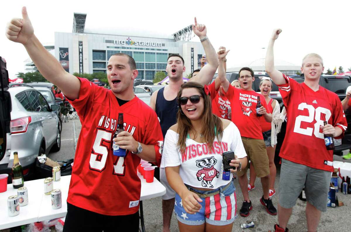 Wisconsin fans cheer as they tailgate before a college football game against LSU at NRG Stadium on Saturday, Aug. 30, 2014, in Houston.