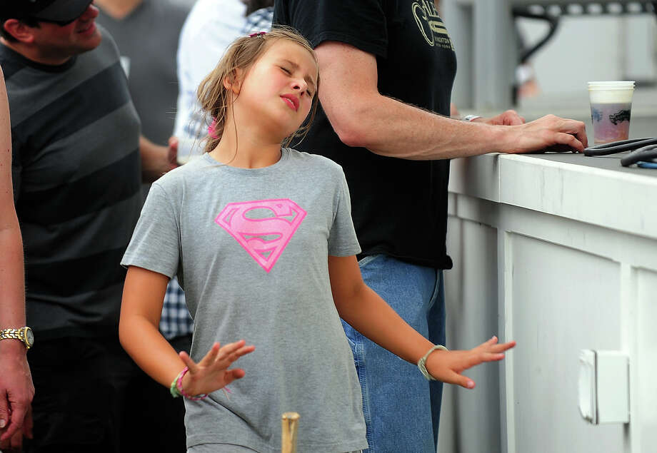 Tori Emmert, 9, of Westport, dances as Big Sam's Funky Nation performs during the 7th Annual Blues Views and BBQ Festival at the Levitt Pavillion in Westport, Conn. on Saturday, Aug. 30, 2014. Photo: Christian Abraham / Connecticut Post
